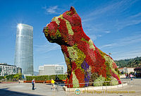 Guggenheim Museum: Puppy in a beautiful coat of flowers which is watered by an internal system