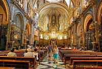 The rich enamelled Montserrat basilica altar with paintings by Catalan artists.