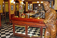 Hemingway in the side bar at the Café Iruña