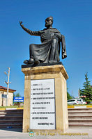 Statue of Hacı Bektaş Veli with some of his teachings on the column