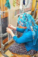 Handweaving silk carpets - a backbreaking task
