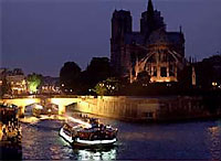 A tourist sightseeing barge outside Notre Dame Cathedral