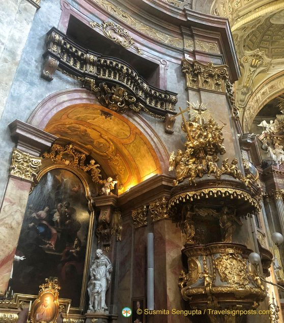 Highly gilded decoration in the interior of Peterskirche near Graben.