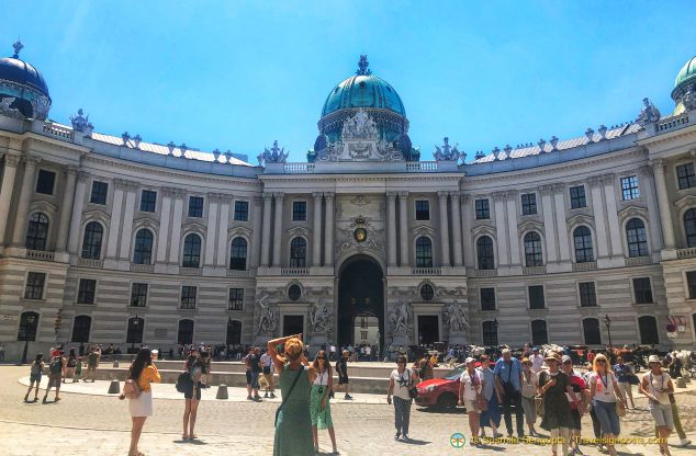 The majestic curved facade of the Hofburg Imperial Palace as viewed from Kohlmarkt.