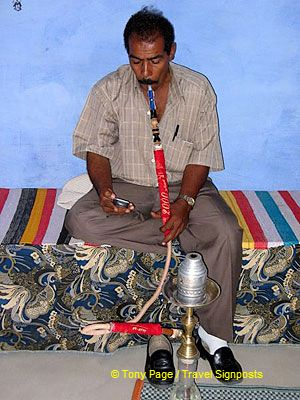 Smoking a water pipe.