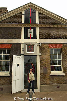 Astride the Prime Meridian, under the Millennium Clock