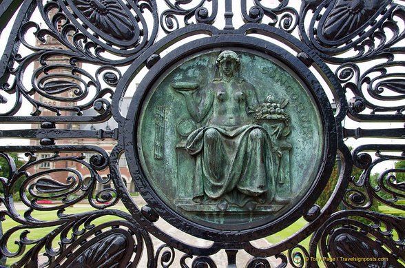Medallions on Entrance gate showing Lady Justice