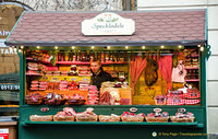 Christmas market stall selling cured meats