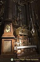 The altar to the right is dedicated to St. Benedict but the sarcophagus is empty.