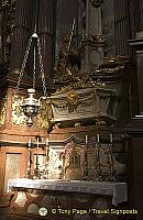 The left side altar in the transept contains the skeleton of St. Coloman in a sarcophagus