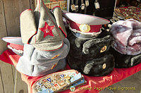 Various Russian hats and medals for sale