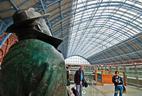 Sir John Betjeman marvelling at the roof of St Pancras
