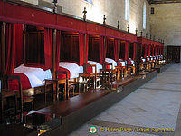 Row of four-poster beds
