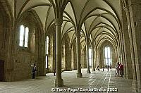 The rib vaults and finely decorated capitals are typically Gothic, Mont-St-Michel [Mont-St-Michel - France]