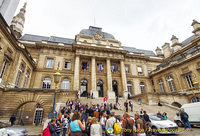 Visitors are part of the 15,000 people that flow through the Palais de Justice each day