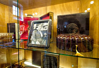Handcrafted leather goods and photo of Marcello Gori, founding father of Scuola del Cuoio