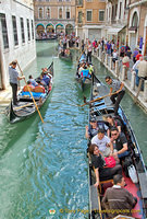 The gondola business goes on as long as the boats are able to make it under the bridges