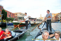 A vaporetto's approaching but the gondoliers are fearless