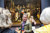 Our museum guide explains the Night Watch