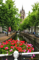 View down the Oude Delft and the Oude Kerk clock tower