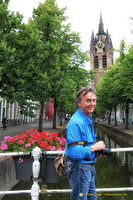 Tony with the Oude Kerk clock tower in the background